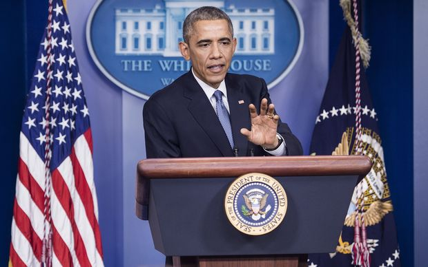 Barack Obama speaking with reporters at the White House on 19 December (local time).