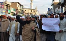 Pakistani Islamists march for the victims of the Peshawar school massacre at a protest in Mansahra.