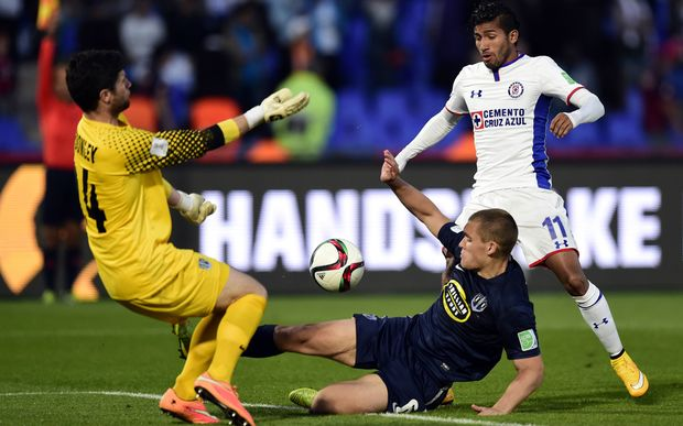 Cruz Azul's forward Joao Rojas (R) is pressured by Auckland City's defender John Irving (C) and goalkeeper Jacob Spoonley during their FIFA Club World Cup third place play-off in Marrakesh.