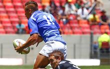 Samoa's Tim Nanai-Williams is tackled by New Zealand's Joe Webber during the South Africa Sevens at Port Elizabeth.