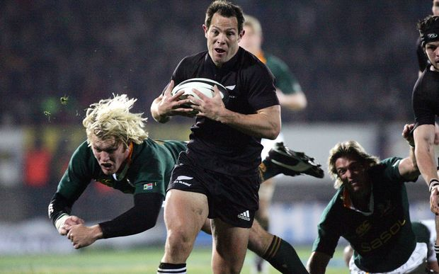Leon Macdonald slips past Schalk Burger for a try during the Tri Nations match againt South Africa at Carisbrook in 2005.