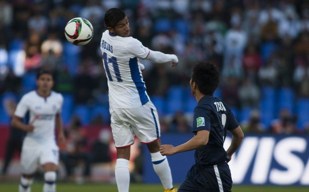 Akuya Iwata (R) of Auckland City in action against Joao Rojas (L) of Cruz Azul.