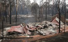Burnt out houses smolder at Kinglake after the Black Saturday bush fires.