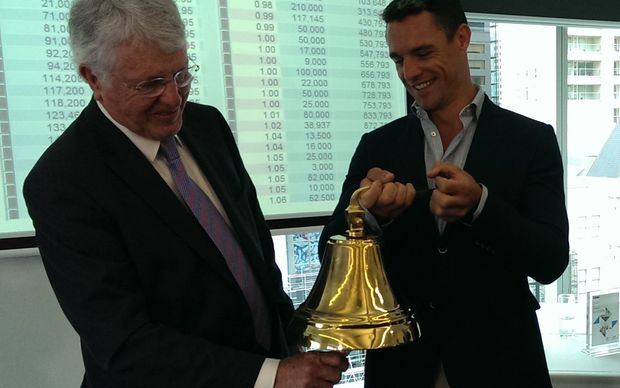 Arvida, chair, Peter Wilson is the first to ring NZX's new bell, held by shareholder and All Black Dan Carter.