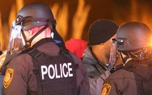 Police confront protestors in Ferguson after the shooting of Michael Brown in November.