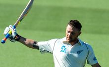 The Black Caps captain Brendon McCullum raises his bat to the crowd.