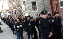 Police officers from the New York City area line up for the wake for Rafael Ramos.