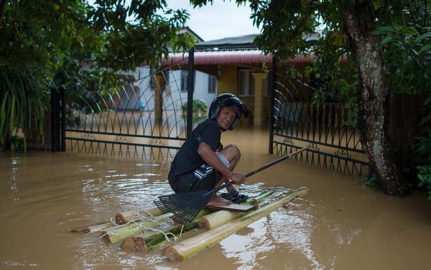 A man makes his way to his house submerged in floodwaters in Pengkalan Chepa, near Kota Bharu in north east Malaysia.