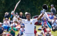 Sri Lankan batsman Dimuth Karunaratne celebrates his maiden test century vs New Zealand 2014.