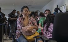 Family members of passengers of missing flight QZ8501 gather at Juanda international airport in Surabaya in East Java.