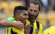 Andrew Durante hugs Roy Krishna after he scores a goal.