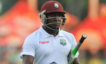 West Indies cricketer Denesh Ramdin trudges off the pitch.