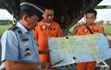 Western Indonesia Air Force operation commander Air Vice Marshal Agus Dwi Putranto (left) briefs crews before the search.