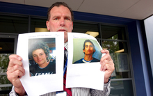 Detective Inspector Scott Beard holds photographs of the wanted teenagers.