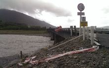 The car crashed through the safety barrier of this bridge just north of Harihari on the West Coast.