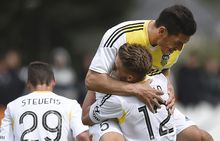 Michael Boxall (L) and Tyler Boyd of the Wellington Phoenix celebrate a goal.