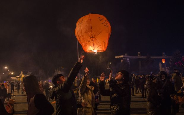 People release a sky lantern to celebrate the New Year in Harbin, China.