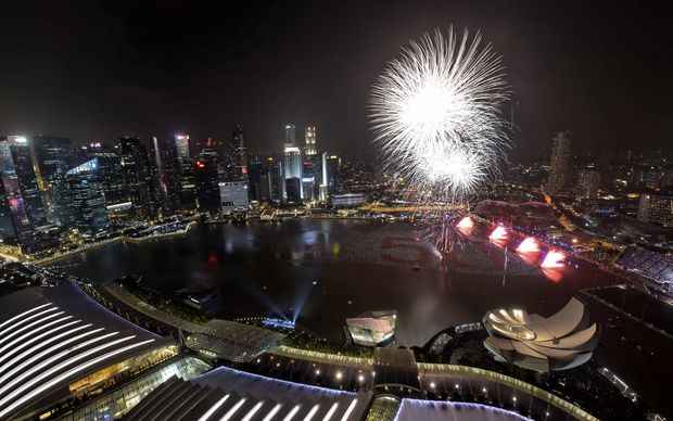 Fireworks burst over the Marina bay to mark the New Year's celebration in Singapore.