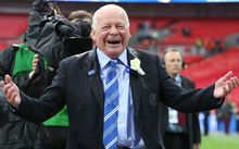The Wigan Athletic chairman Dave Whelan laughs as he is soaked with champagne.