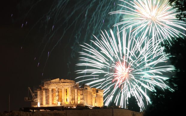 Fireworks light up over the ancient Parthenon temple at the Acropolis Hill in Athens.