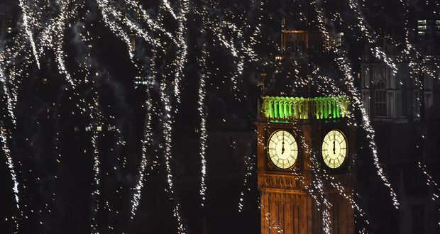 Fireworks explode above the Elizabeth Tower, also known as 'Big Ben', during celebrations in central London just after midnight on 1 January 2015.