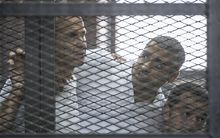 Al-Jazeera news channel's Australian journalist Peter Greste, left, and his colleagues, Egyptian-Canadian Mohamed Fadel Fahmy, centre, and Egyptian Baher Mohamed listen to the original verdict in June.