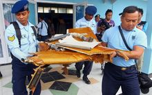 Indonesian military officers carry wreckage from AirAsia QZ8501 in Pangkalan Bun, the town with the nearest airstrip to the crash site, on 2 January.