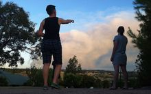 People watch a bushfire at Humbug Scrub near Kersbrook, north-east of Adelaide.