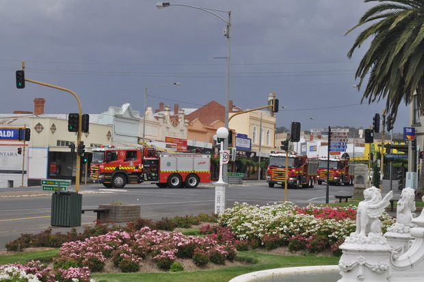 A convoy of CFA tankers roars through the centre of Ararat, Victoria, as fires rage near the town.