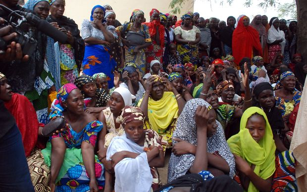 Mothers of the missing schoolgirls abducted by Boko Haram Islamists gather to receive infomations from officials on 5 May 2014.