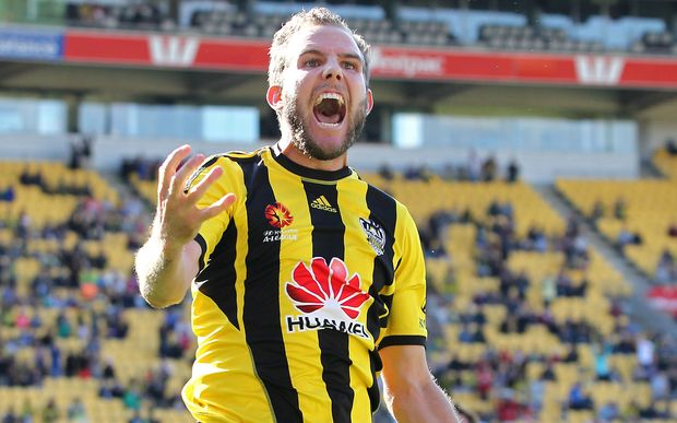 Jeremy Brockie celebrates scoring the first of his two goals in his last Phoenix game