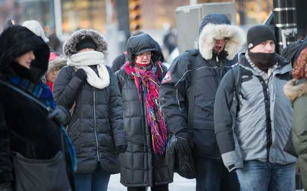 Commuters battle through extreme cold in Chicago, Illinois.