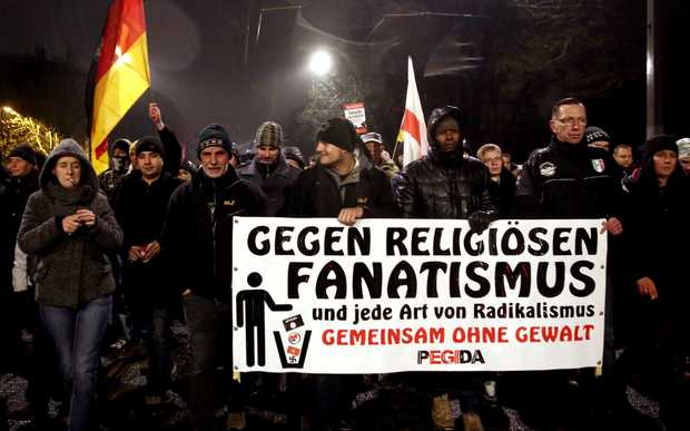 Supporters of the Pegida movement (Patriotic Europeans Against the Islamisation of the Occident) gather for another of their weekly protests in Dresden, Germany.