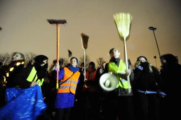 Demonstrators with brooms protest against a rally by a mounting right-wing populist movement - Pegida - on January 5, 2015 in Dresden, Germany.