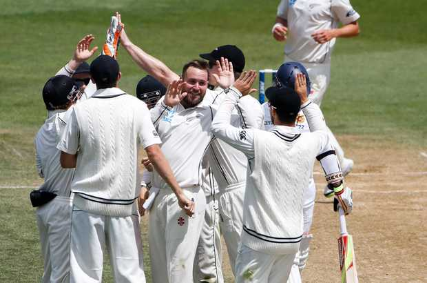 Mark Craig and the team celebrate the wicket of Rangana Herath. Fifth day, second test, ANZ Cricket Test series, New Zealand Black Caps v Sri Lanka, 07 January 2015, Basin Reserve, Wellington, New Zealand.