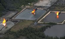 A picture taken in March 2013 shows gas flare at Shell Cawtharine Channel in Nembe Creek in the Niger Delta.