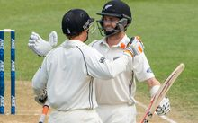 Kane Williamson celebrates his maiden test double century with teamate BJ Watling.
