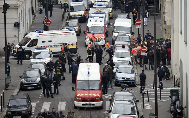 Firefighters, police officers and forensics gathered in front of the offices of the French satirical newspaper Charlie Hebdo.
