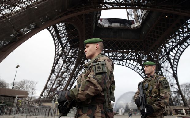 French soldiers patrol in front of the Eiffel Tower following the Paris shooting.