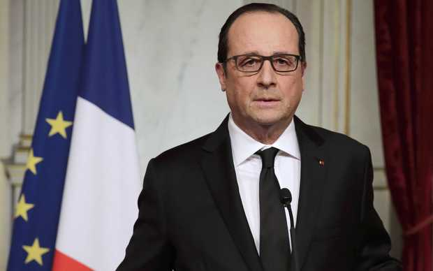 French President Francois Hollande reacts to the killings at the Elysee Palace in Paris.