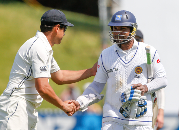 Ross Taylor congratulates Kumar Sangakkara on his century on the second day of the second test.