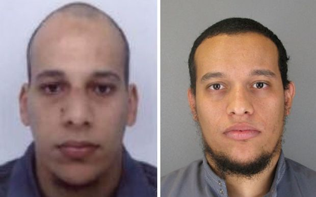 Handout photos released by French police show suspects Cherif Kouachi (L), aged 32, and his brother Said Kouachi (R), aged 34.