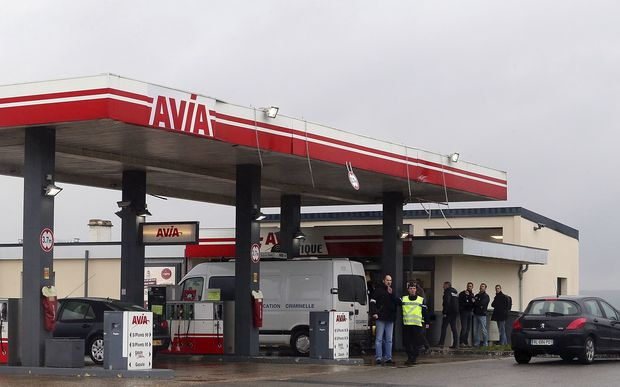 A Gendarmerie criminal identification van is parked in front of an Avia gas station in Villers-Cotterets.