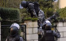 Members of the French police special force GIPN carry out searches in northern France.