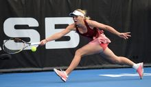 Caroline Wozniacki stretches for the ball at the ASB Tennis Centre