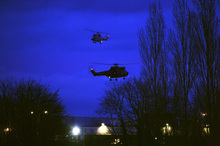 Helicopters fly over buildings in Dammartin-en-Goele, north-east of Paris, after the standoff between the two suspects and special forces.