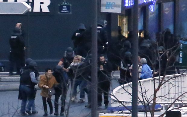 Members of the French police special forces evacuate the hostages after launching the assault in Paris.