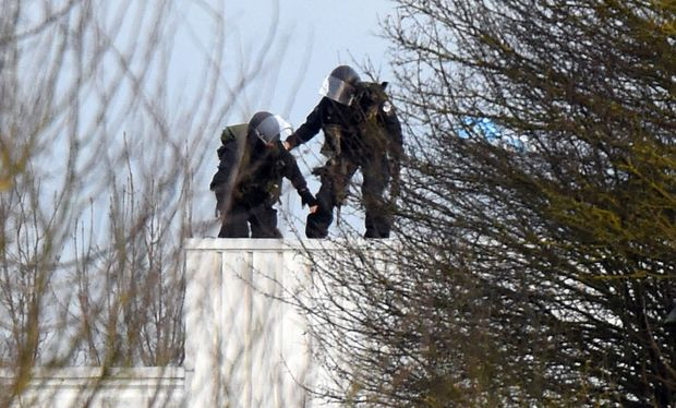 Police take up a position on a roof in Dammartin-en-Goele, north-east of Paris.