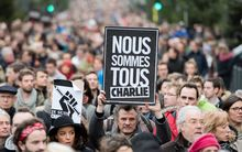 "A man holds a sign reading ""We are all Charlie"" at a rally in the city of Lille, northern France."