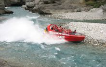 Five people were taken to hospital when the jet boat they were in hit a rock.